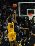 Missouri forward Ricardo Ratliffe shoots over Georgetown forward Julian Vaughn in the first half of Mizzou's 111-102 overtime loss to Georgetown at the Sprint Center in Kansas City on Tuesday night. (Photo by Ross Taylor)