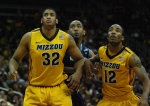 Missouri forward Steve Moore (32) and guard Marcus Denmon (12) combine to box out a Georgetown forward following a Georgetown free throw in the first half of Mizzou's 111-102 overtime loss to Georgetown at the Sprint Center in Kansas City on Tuesday night. (Photo by Ross Taylor)