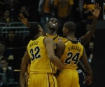Mizzou forward Ricardo Ratliffe (center) celebrates a basket and a foul with teammates Steve Moore (32) and Kim English (24) in the first half of Mizzou's 111-102 overtime loss to Georgetown at the Sprint Center in Kansas City on Tuesday night. (Photo by Ross Taylor)