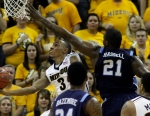 Matt Pressey gets off the shot under that basket around ODU's Frank Hassell.