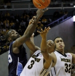 Matt Pressey (3) fouls Ben Finney for Old Dominion as Steve Moore (32) watches the play.