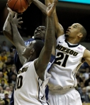 Ricardo Ratliffe (10) and Laurence Bowers try to block a shot.