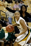 Mizzou's RaeShara Brown works the floor as UAB coach Audra Smith yells to her team in the background.