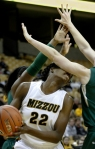 BreAnna Brock (22) catches an arm to the face under the basket.