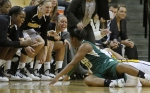 Players on the Missouri bench yell at teammate RaeShara Brown as she fights for a loose ball with a UAB player.