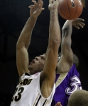 Justin Safford (23) fights for a rebound. He finished with eight rebounds and 16 points.