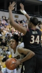 Florida State's Chelsea Davis (34) towers over Shakara Jones as she tries to drive to the basket.