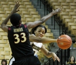 Mizzou's Jasmyn Otote passes around defender Natasha Howard.
