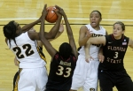 BreAnna Brock (22) fights for the rebound with Natasha Howard (33) as RaeShara Brown (23) and Alexa Diluzio watch.