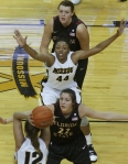 Shakara Jones (44) sets up at the post, looking for the pass from teammate Tori Niemann (12).