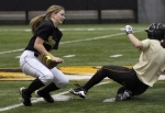 Abby Vock, left, is unable tag out the runner sliding into second base. (Photo by Karen Mitchell)