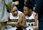 RaeShara Brown, left, and Shakara Jones talk during a time out. Brown finished with 21 points, Jones with 14.