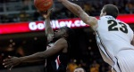 Mizzou forward Justin Safford extends to impede a Texas Tech lay up attempt. Safford did not record a block in the game, but still made a solid contribution off the bench.