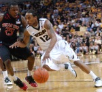 Mizzou guard Marcus Denmon (12) drives past Texas Tech defender David Tairu (25) in the first half of Mizzou's victory over the Red Raiders on Tuesday, February 15, 2011 at Mizzou Arena in Columbia.