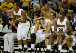 A range of emotions is shown by the Missouri bench in overtime, including cheering by Trenee Thornton (left) and a bowed head by Bailey Gee (2).