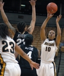 Jasmyn Otote looks for an open pass under the hoop. Otote had eight points in 28 minutes for the Tigers.