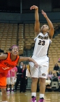 RaeShara Brown puts up a jumper over Tiffany Bias. Photo by Chris Spurlock.