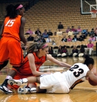 RaeShara Brown battles for a loose ball on the floor. Photo by Chris Spurlock.