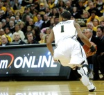"""Missouri guard Phil """"Flip"""" Pressey darts around CU backcourt pressure in the first half Saturday. Pressey nabbed five steals and dished out three assists while only giving up one turnover. Missouri guard Kim English shoots over CU guard Alec Burks. Both players scored 21 poinst in the Tiger's victory at Mizzou Arena on Saturday, February 5, 2011. (Photo by Nick Gerhardt)"""