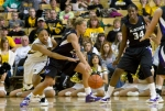 RaeShara Brown (23) tries to steal the ball from Brittany Chambers (2).