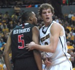 Missouri forward Ricky Kreklow helps up Red Raiders forward D'walyn Roberts after Kreklow delivered a hard foul on the breakaway.  Kreklow hit 75 percent of his shots and one-of-two from three for seven points