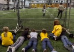 Young fans sit behind a protective fence to watch the game. (Photo by Karen Mitchell)
