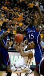 Phil Pressey tries to put up a layup but is fouled hard by Elijah Johnson. Photo by Chris Spurlock.