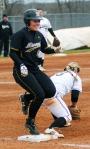 Mizzou's Nicole Hudson touches first base a fraction of a second after the ball arrives and is called out. Hudson also drew a walk and later scored during the Tigers' dominating performance.