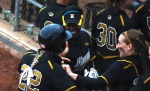 Teammates congratulate Lindsey Muller (22) of Mizzou after her home run, the first of two Tiger homers during the five-inning blowout.