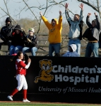 Missouri fans celebrate after Abby Vock's hit clears the left field wall, out of the reach of Oklahoma's Brittany Williams.