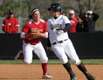 Missouri's Ashley Fleming gets caught in a rundown and is tagged out by Oklahoma third baseman Dani Dobbs.