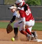 Abby Vock watches as the balls bounces away, allowing Oklahoma's Destinee Martinex to slide safely into second.