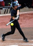 Mizzou batter Princess Krebs connects on one of her three hits in four at bats, the best average of any Tiger against Oklahoma pitcher Keilani Ricketts.  (Photo by Nick Gerhardt)