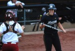 Mizzou catcher Megan Christopher, 16, laughs with Oklahoma rival catcher Jessica Shults in an eventual Mizzou victory in Columbia on Saturday.  (Photo by Nick Gerhardt)
