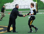 "Athletic Director Mike Alden, left) hands Tyler Gabbert the ""Most Improved Quarterback"" award during halftime of the Black & Gold spring scrimmage.  (Photo by Nick Gerhardt)"