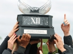 The Missouri softball team celebrates with the 1997 Big 12 championship trophy.