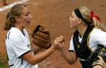 Kristin Nottelmann, left, and Megan Christopher celebrate getting out of a tight inning.