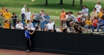 Fans try to catch Ashley Flemings homerun ball in right field.