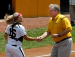 Megan Christopher shakes hands with Missouri Gov. Jay Nixon after he threw out the first pitch on Sunday.