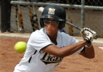 "Usually a slap hitter, Rhea Taylor hit a home run in each of Sunday's games. ""But if I'm going to hit away, it needs to be a home run,"" Taylor said."