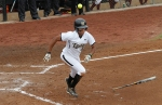 With ball and bat flying Rhea Taylor heads to first base.