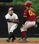 Missouri's Abby Vock runs down Iowa State's Evan Folks for an out.