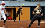 Kristin Nottlemann throws to Abby Vock at first base.