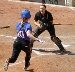 Mizzou catcher Megan Christopher tries to make a play on DePaul's Lindsey Dean as she charges home.