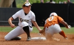 Missouri's Jenna Marston tags out Brejae Washington at second.