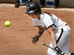 Lisa Simmons lays down a bunt for a hit.