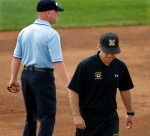 Coach Ehren Earleywine walks away after talking to one of the umpires about a call Earleywine disagreed with.