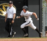 Abby Vock runs around third base past coach Ehren Earleywine, but the fielder's choice out ending the inning without Vock scoring.