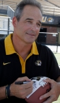 Coach Gary Pinkel chats with fans as he signs a football Sunday. This is Pinkel's 11th year with the Tigers.