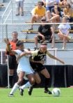 Alyssa Diggs, left, struggles with Kellie Phillips of Purdue for the ball on Sunday, Aug. 28, 2011 at Walton Stadium.
